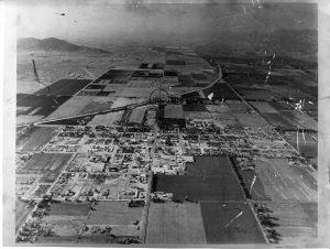 This 1954 aerial of Scottsdale shows the incorporated area surrounded by farm fields.  The center circle marks the intersection of Scottsdale and Camelback roads at the Arizona Canal.  Photo courtesy of Scottsdale Historical Society